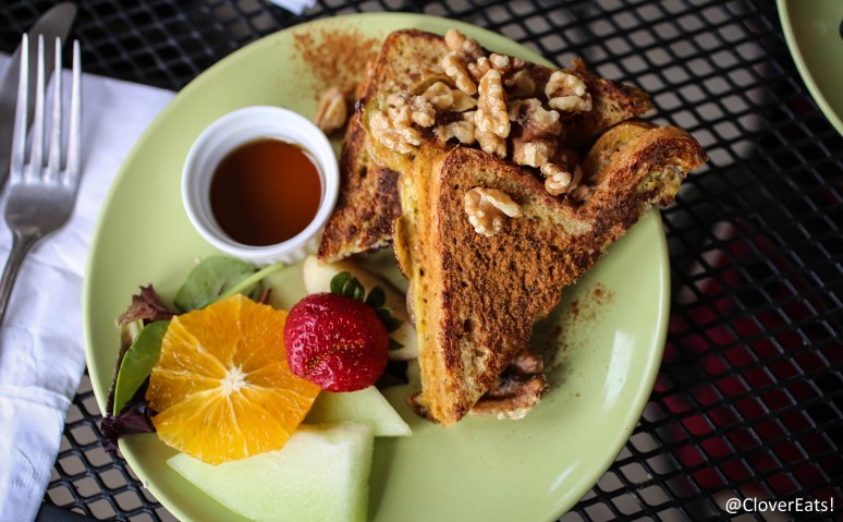 "French toast - ""Avalon organic soft whole wheat bread layered w/light cream cheese, maple syrup caramelized apples, cinnamon & raisins.  Topped w/toasted walnuts & served w/warm maple syrup."""
