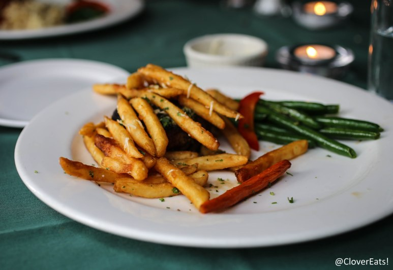 PETIT FILET  - A 6 OZ. BEEF TENDERLOIN SIMPLY GRILLED AND SERVED WITH A MAITRE' D BUTTER; FINISHED WITH A HANDFUL OF PARMESAN-TRUFFLE FRENCH FRIES