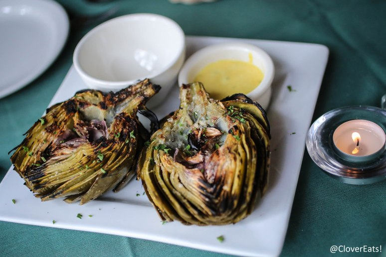 GRILLED ARTICHOKE - A WHOLE ARTICHOKE, STEAMED WITH WHITE WINE & HERBS; BRUSHED WITH OLIVE OIL, GRILLED AND SERVED WITH A MUSTARD AIOLI