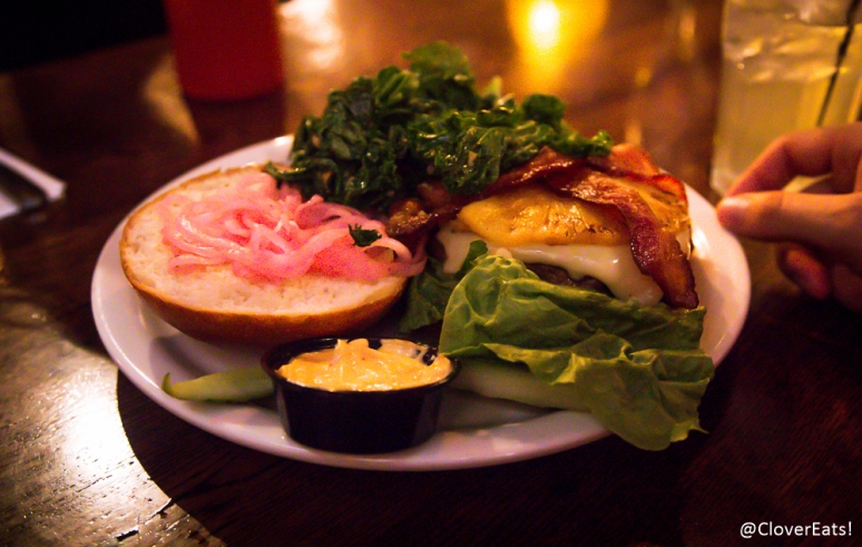 Maui Burger - ground beef patty topped with pepper jack cheese, smoked applewood bacon, pickled red onion, grilled pineapple, romaine lettuce with chipotle mayo