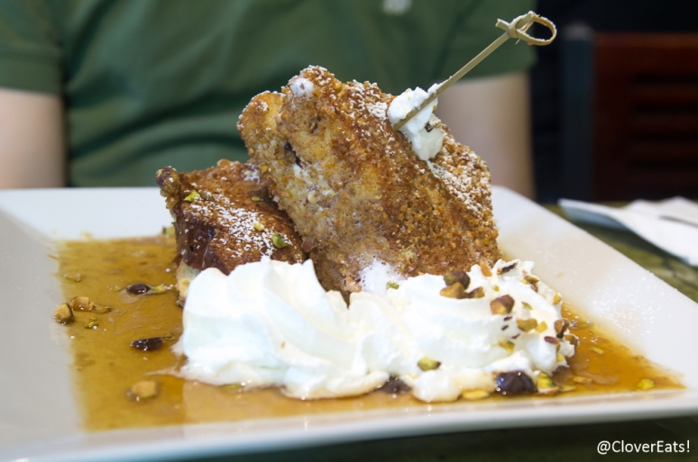 Cannoli French Toast: Texas brioche encrusted in an almost crunch filled with creamy cannoli filling with chocolate chips and pistachios in a brandy maple syrup