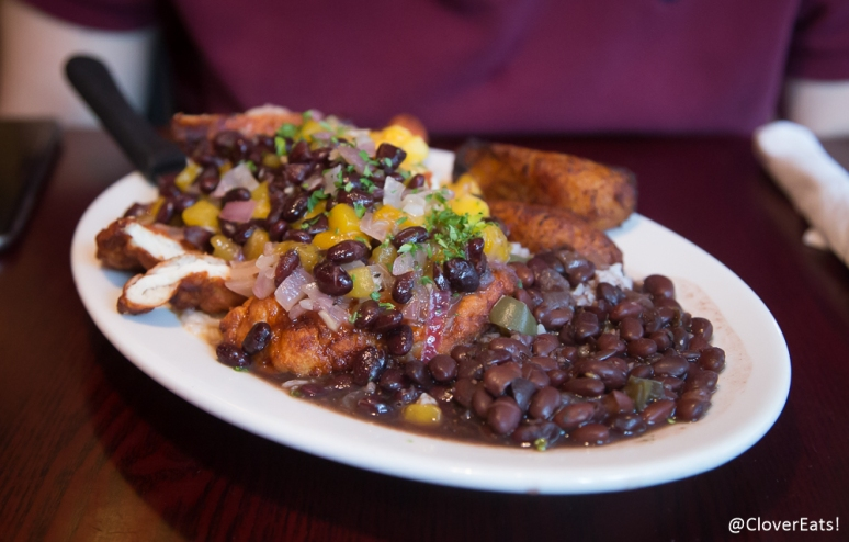 pollo moderno marinated chicken breast breaded and lightly fried served under our mango, guava, pineapple and black bean salsa served with arroz blanco, frijoles negros and platanos maduros