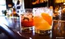 Untitled #2 (bourbon, peach oolong sweat tea, grapefruit) and Manaplan (rum, suze, strawberry baslsamic shrub, grapefruit and mojito mint)