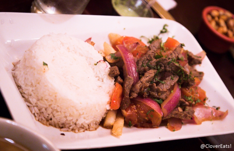 Lomo Saltado - chunks of beef with onions, tomatoes, french fries