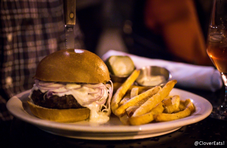 """painted hills grass-fed beef, brioche bun, red onion, frites aioli, house pickles, sharp cheddar"""