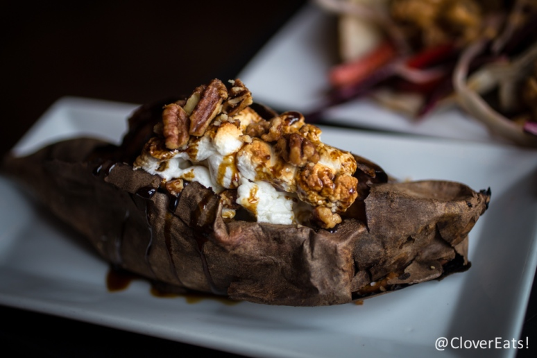 Fully Loaded Sweet Potato slow roasted, candied whiskey pecans, maple sugar, torched marshmallows & molasses