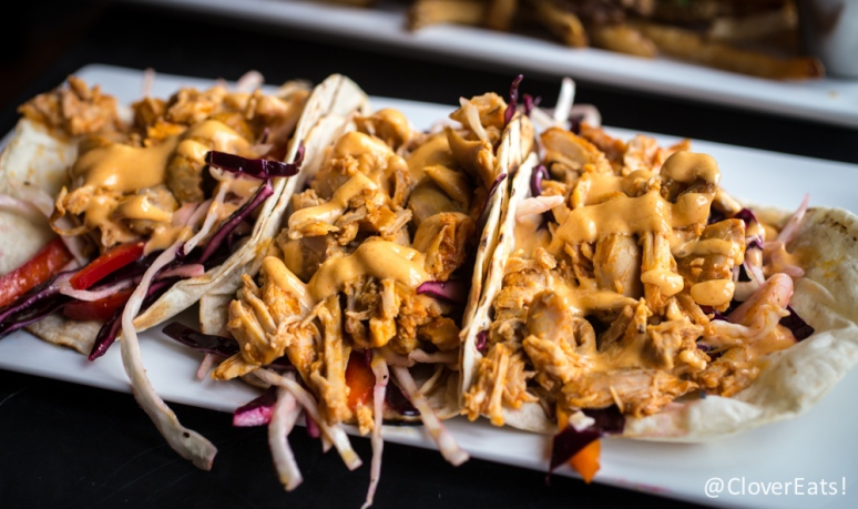 Jerk Chicken Tacos flour tortilla, spicy cabbage slaw, pulled jerk chicken, spicy aioli