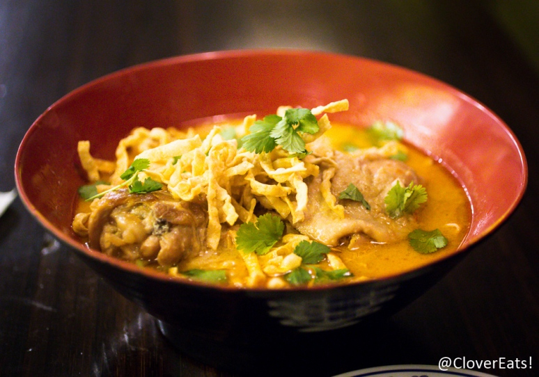 Khao Soi - Northern Thai mild curry noodle soup made with our secret curry paste recipe and house-pressed fresh coconut milk. Served with house pickled mustard greens, shallots, crispy yellow noodles and roasted chili paste.