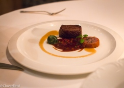 "SIRLOIN OF MIYAZAKI WAGYU* ""Saucisse Fumée,"" Wilted Arrowleaf Spinach, Sweet Carrots, and ""Steak Sauce"""